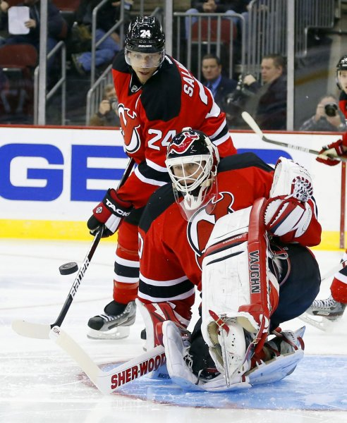 New Jersey Devils Bryce Salvador and Martin Brodeur are shown during a January 2013 game in Newark, N.J. The Devils on Monday said Brodeur may soon return from a back injury. UPI/John Angelillo