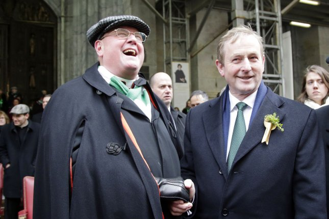 Irish Prime Minister Enda Kenny meets with New York Archbishop Timothy Dolan as the St. Patrick's Day Parade marches up Fifth Avenue in New York City on March 17, 2014. UPI/John Angelillo