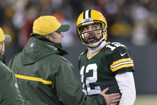Green Bay Packers head coach Mike McCarthy (R) talks with quarterback Aaron Rodgers during the fourth quarter against the New England Patriots at Lambeau Field on November 30, 2014 in Green Bay, Wisconsin. The Packers defeated the Patriots 26-21. UPI/Brian Kersey