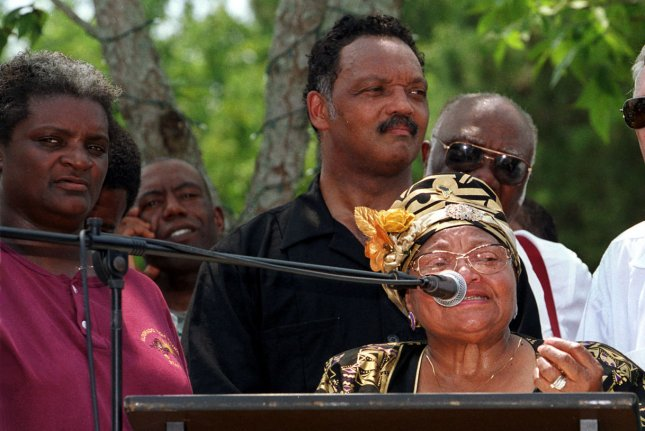 Mamie Mobley, whose 14-year-old son Emmett Till was killed in Mississippi in 1955, supposedly for whistling at a white woman, speaks to demonstrators in Kokomo, Miss., in 2000. She became a civil rights leader and educator, and died in 2003. The Justice Department on Thursday reopened Till's murder case. Photo by AJ Sisco/UPI