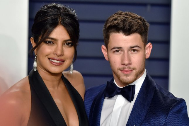 Priyanka Chopra (L), pictured with Nick Jonas, shared wedding details on Watch What Happens Live. File Photo by Christine Chew/UPI