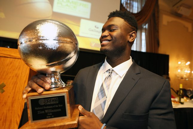 Zion Williamson of Duke University looks at his award during ceremonies at the Missouri Athletic Club in St. Louis on April 15. Williamson is projected to be the No. 1 overall pick in next month's NBA Draft. File Photo by Bill Greenblatt/UPI