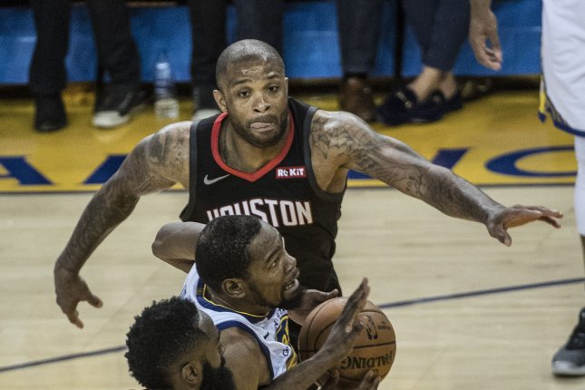 Houston Rockets forward P.J. Tucker cited an ankle injury when withdrawing from the U.S. national team. File Photo by Terry Schmitt/UPI