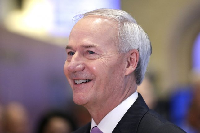 Arkansas Gov. Asa Hutchinson said he aims to deliver his state an off-ramp to COVID-19 restrictions, by removing penalties last month and lifting the mask order by March 31 if it meets certain requirements. Photo by John Angelillo/UPI