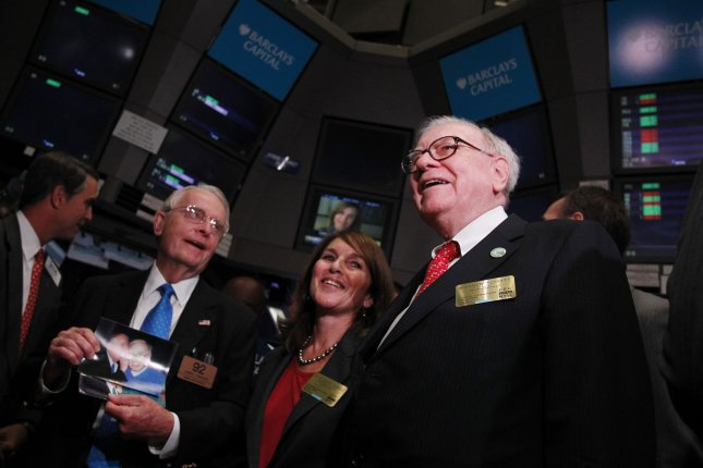 Berkshire Hathaway Chairman Warren Buffett (R)emphasized that his resignation from the board is not a signal of retirement or stepping back from investing. File Photo by John Angelillo/UPI