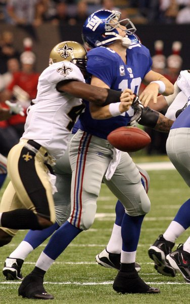 New York Giants quarterback Eli Manning is stripped of the ball by New Orleans Saints safety Roman Harper, putting the Saints in scoring position at the end of the first half at the Louisiana Superdome in New Orleans on October 18, 2009. UPI / A.J. Sisco