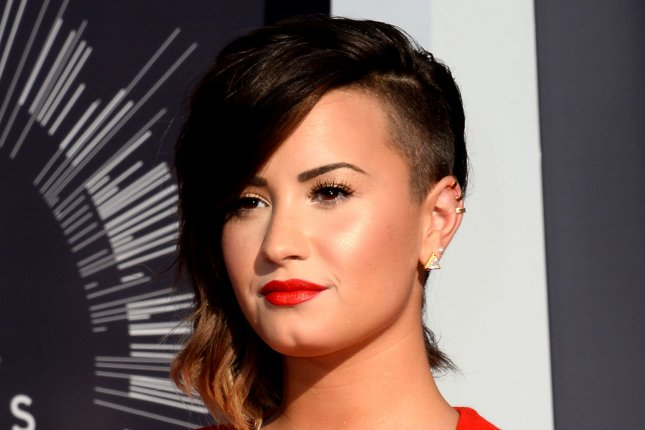 Demi Lovato nearly returned to rehab for an eating disorder in summer 2013. UPI/Jim Ruymen