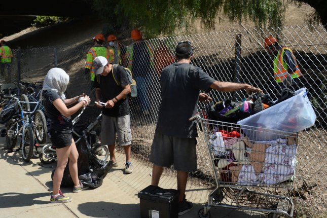 A homeless encampment under the Hollywood Freeway is dismantled in Los Angeles on August 23. The City of Los Angeles declared a state of emergency in September in order to free up funds to help the homeless, the same as the governor of Hawaii has now done.. Photo by Jim Ruymen/UPI