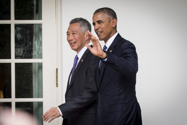 President Barack Obama and Prime Minister Lee Hsien Loong of Singapore make their way to the Oval Office on Tuesday for a meeting following a State Welcome Ceremony on the South Lawn of the White House. Lee is in the United States to discuss counter-terrorism measures and the Trans-Pacific Partnership with Obama. Photo by Pete Marovich/UPI