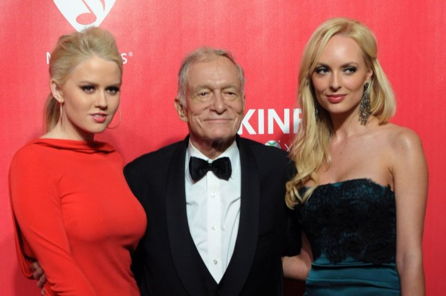 Kristina Shannon, Hugh Hefner and Karissa Shannon (L-R) arrive for the MusiCares Person of the Year Tribute to Paul McCartney held at the Los Angeles Convention Center in Los Angeles on February 10, 2012. Hefner died Wednesday at the age of 91. File Photo by Jim Ruymen/UPI