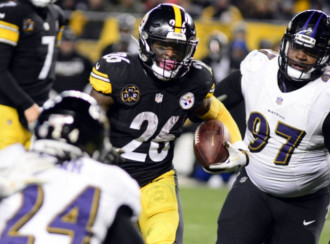 Pittsburgh Steelers running back Le'Veon Bell scoots past Baltimore Ravens nose tackle Michael Pierce for a touchdown during their game last week. Photo by Archie Carpenter/UPI