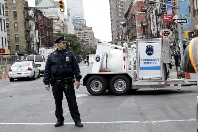An NYPD Emergency Services vehicle transports a suspicious package Friday. Photo by John Angelillo/UPI