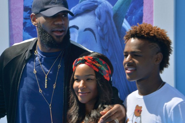 LeBron James with his wife Savannah James and their son LeBron James Jr. (L-R) on September 22 at the Regency Village Theatre in the Westwood section of Los Angeles. Photo by Jim Ruymen/UPI
