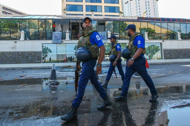 Soldiers patrol an area in Colombo, Sri Lanka, on Wednesday -- three days after a series of suicide bombings killed more than 250 people. Photo by Perera Sameera/UPI