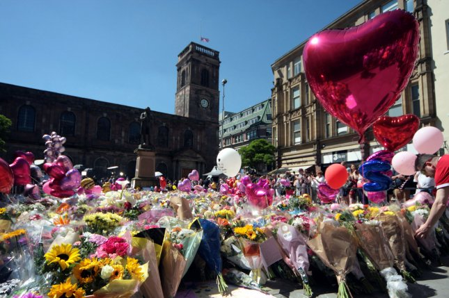 Flowers and other items form a makeshift memorial for the victims of a suicide attack at an Ariana Grande concert in central Manchester, Britain, on May 26, 2017. File Photo by Mushtaq Mohammed/UPI