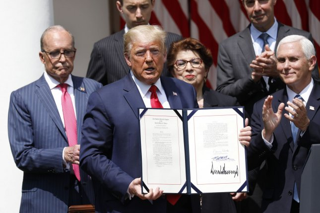 President Donald Trump signs the Paycheck Protection Program Flexibility Act of 2020 in the Rose Garden of the White House on Friday. Photo by Yuri Gripas/UPI