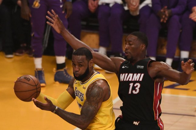 Bam Adebayo (R) is now under contract for the next six seasons after he agreed to a five-year extension on Tuesday with the Miami Heat. File Photo by Jon SooHoo/UPI