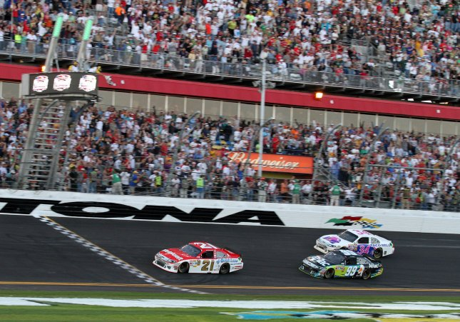 Trevor Bayne (21) takes the checkered flag and the victory becoming the youngest driver in NASCAR history to win the Daytona 500 at Daytona International Speedway in Daytona Beach, Florida on February 20, 2011. UPI Photo/Martin Fried