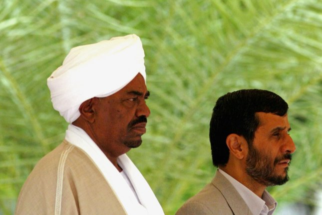 Iran's President Mahmoud Ahmadinejad (R) and Sudanese President Omar al-Bashir are seen in an April 26, 2006 file photo in Tehran, Iran. The International Criminal Court issued an arrest warrant March 4, 2009 for Sudanese President Omar al-Bashir on charges of war crimes and crimes against humanity in Darfur. (UPI Photo/Mohammad Kheirkhah)