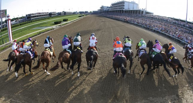 Kentucky Derby horses break from the starting gate for the start of the 140th running of the Kentucky Derby at Churchill Downs in Louisville, Kentucky on May 3, 2014. UPI/John Sommers II