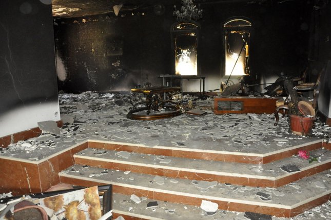 A burnt building is seen at the United States consulate, one day after armed men stormed the compound and killed the U.S. Ambassador Christopher Stevens and three others in Benghazi, Libya on September 12, 2012. UPI/Tariq AL-hun