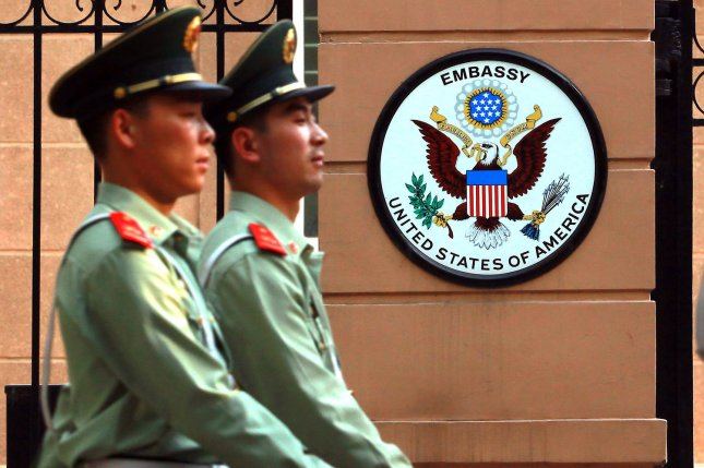 Chinese soldiers march past part of the United States Embassy in Beijing on May 20, 2014. UPI/Stephen Shaver
