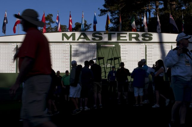 Patrons gather near the Masters scoreboard during a practice round before the 2016 Masters Tournament at Augusta National in Augusta, Georgia on April 5, 2016. Photo by Kevin Dietsch
