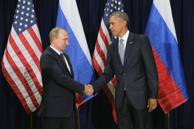 Russian President Vladimir Putin (L) and U.S. President Barack Obama shake hands for the cameras before the start of a bilateral meeting at the United Nations in New York City in 2015. The Kremlin said Wednesday nearly all communication channels between the U.S. and Russia are frozen. File Pool Photo by Chip Somodevilla/UPI