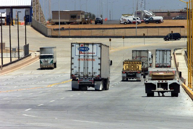 Trucks cross the World Trade Bridge which links Nuevo Laredo, Mexico to Laredo, Texas. Americans are nearly evenly divided on whether the North American Free Trade Agreement was a good thing or a bad thing for the United States. U.S. President Donald Trump has vowed to withdraw or renegotiate from NAFTA, which he has said is a bad deal that benefits Mexico and Canada at the expense of the United States. File Photo by Joe Mitchell UPI
