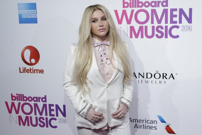Kesha arrives on the red carpet at the Billboard Women in Music 2016 event on December 9. The singer's former producer Dr. Luke is no longer the CEO of Kemosabe Records. File Photo by John Angelillo/UPI