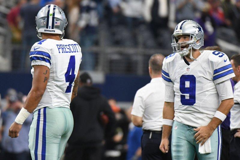 Dallas Cowboys quarterback Tony Romo, right, talks to his former backup Dak Prescott as they warm up prior to facing the Baltimore Ravens on November 20 at AT&T Stadium in Arlington, Texas. File photo by Ian Halperin/UPI