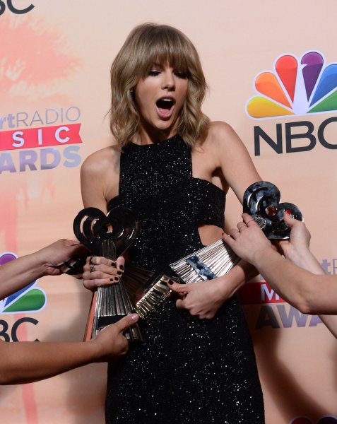 Taylor Swift poses backstage with the awards at the iHeartRadio Music Awards in Los Angeles on March 29, 2015. On Sunday, Swift won again for best female artist. File Photo by Jim Ruymen/UPI