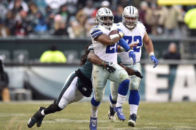 Dallas Cowboys running back Ezekiel Elliott (21) runs the ball as he is tackled by Philadelphia Eagles linebacker Dannell Ellerbe (57) during the fourth quarter on December 31 at Lincoln Financial Field in Philadelphia. Photo by Derik Hamilton/UPI
