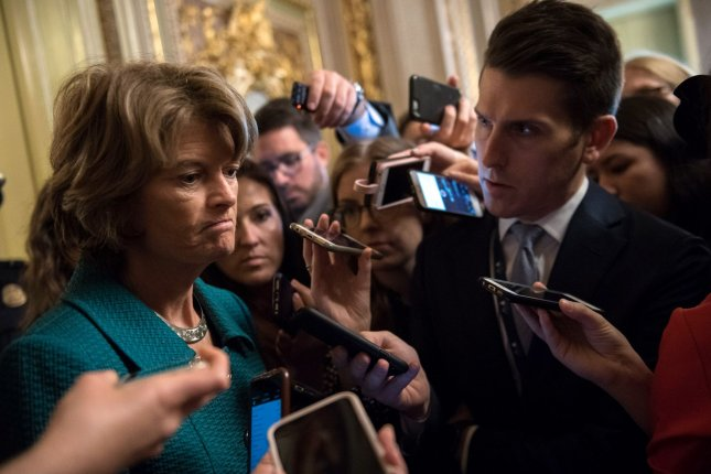 Sen. Lisa Murkowski, R-Alaska, speaks to reporters after voting no on cloture for Supreme Court Justice nominee Brett Kavanaugh, on Capitol Hill on Friday. Photo by Kevin Dietsch/UPI