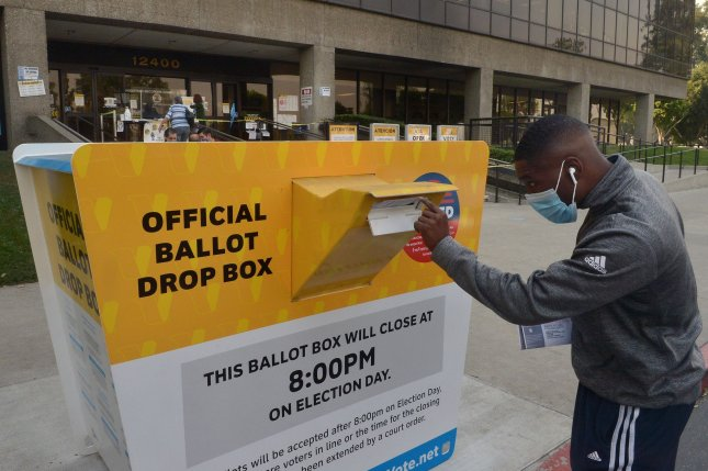 A voter deposits a ballot in a drop box at the Los Angeles County Registrar in Norwalk, Calif., on  Tuesday. Photo by Jim Ruymen/UPI