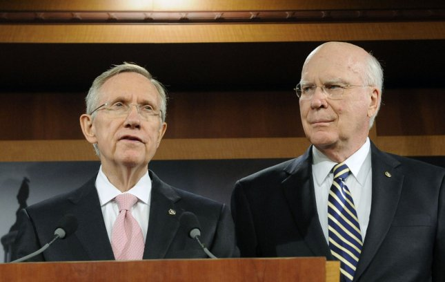 Senate Majority Leader Harry Reid (D-NV) speaks, as Senate Judiciary Committee Chairman Patrick Leahy (D-VT) looks on, after the Senate confirmed Judge Sonia Sotomayor to the U.S. Supreme Court on Capitol Hill in Washington on August 6, 2009. UPI/Alexis C. Glenn
