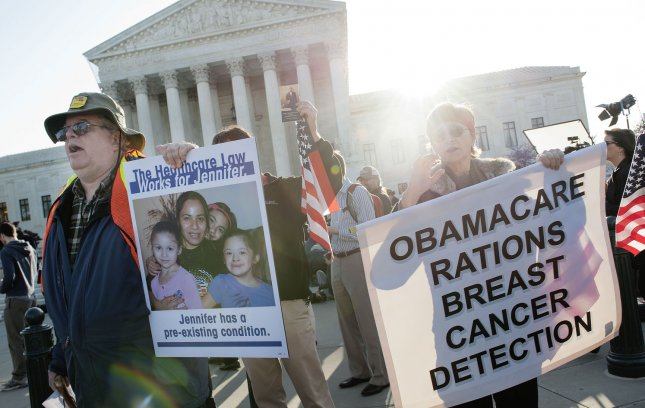 Pro and Anit-health care reform supporter protests in front of the U.S. Supreme Court as the court begins hearing arguments on the constitutionality of President Obama's health care bill in Washington, D.C. on March 26, 2012. UPI/Kevin Dietsch
