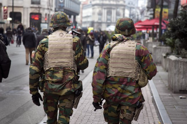 Belgian troops on Thursday patrol a road leading to Zaventem airport following Tuesday's airport bombings in Brussels, Belgium. Two days ago, bomb blasts claimed by ISIL hit Brussels' airport and the Maelbeek subway station, killing dozens. Photo by Albert Masias/ UPI