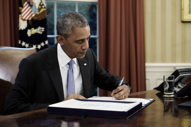 U.S. President Barack Obama signs the FOIA Improvement Act of 2016 in the Oval Office at the White House in Washington, D.C. on June 30, 2016. Pool photo by T.J. Kirkpatrick/UPI