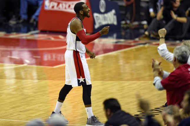 John Wall scored 34 points and handed out 14 assists, and the Wizards used a fourth-quarter rally to defeat the Los Angeles Lakers 119-108 on Tuesday night at Staples Center. File Photo by Mark Goldman/UPI