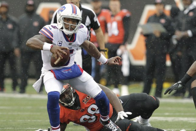 Buffalo Bills quarterback Tyrod Taylor (5) fights to break free from Cincinnati Bengals defender Andrew Billings (99) during the second half of play on October 8, 2017 at Paul Brown Stadium in Cincinnati, Ohio. Photo by John Sommers II/UPI