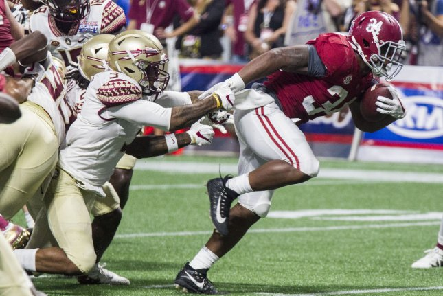 Florida State Seminoles safety Derwin James (3) attempts to tackle Alabama running back Damien Harris on his way into the end zone in the second half of the Chick-fil-A Kickoff game on September 2, 2017 at Mercedes-Benz Stadium in Atlanta. Photo by Mark Wallheiser/UPI