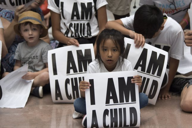Children participate in a protest against the separation of children from parents detained at the border in the Senate Hart Office Building on Thursday. Photo by Kevin Dietsch/UPI
