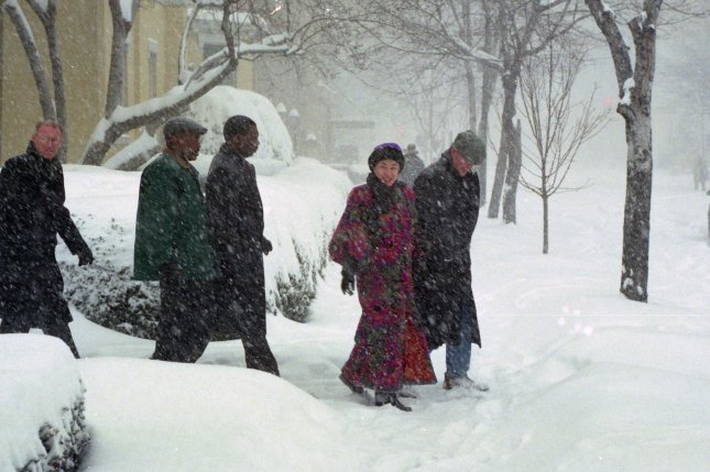 President Bill Clinton and first lady Hillary Rodham Clinton walk back to the White House through a snow storm after attending church at nearby St. John's on Lafayette Square on January 6, 1996. The Blizzard of 1996 began on this day, dropping up to 4 feet of snow and paralyzing Washington, D.C., Baltimore, Philadelphia and other major cities in the Northeast. File Photo by Ken Cedeno/UPI
