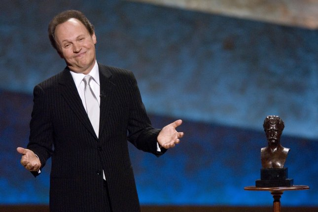 Billy Crystal stands next to his Mark Twain Prize for American Humor at the Kennedy Center in Washington on October 11, 2007. (UPI Photo/Scott Suchman/Kennedy Center)