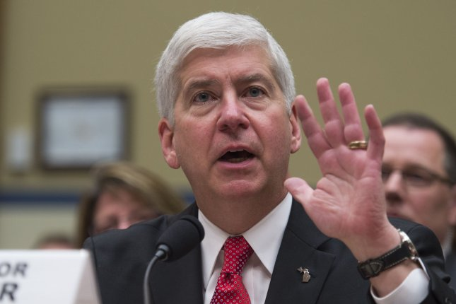 Michigan Gov. Rick Snyder testifies before the House Oversight and Government Reform Committee hearing on March 17, as part of the congressional investigation into the water crisis in Flint, Mich. Snyder has proposed a plan to address the lead-tainted water, but it falls short of what many residents want -- the total removal of lead pipes in the city. Photo by Molly Riley/UPI