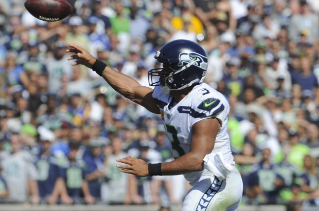 04c605f6a Seattle Seahawks quarterback Russell Wilson makes a pass in the first half  against the Los Angeles Rams at the Memorial Coliseum in Los Angeles