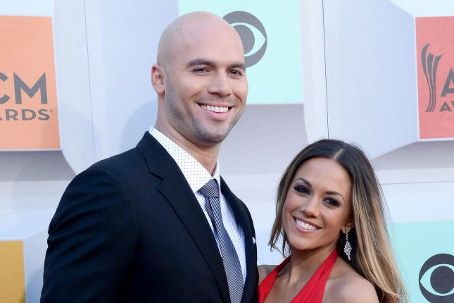 Jana Kramer (R), pictured with Mike Caussin, shared photos Sunday from their vow renewal ceremony. File Photo by Jim Ruymen/UPI
