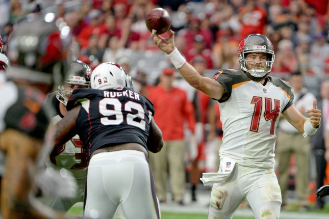 Tampa Bay Buccaneers quarterback Ryan Fitzpatrick (14) throws a pass against Arizona Cardinals defensive lineman Frostee Rucker (92) in the fourth quarter against the Arizona Cardinals on October 15, 2017 at University of Phoenix Stadium in Glendale, Arizona. Photo by Art Foxall/UPI