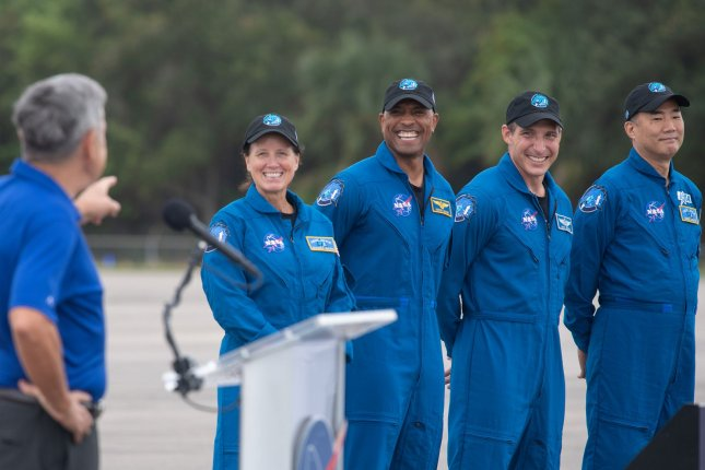Kennedy Space Center Director Bob Cabana on Sunday introduces the astronauts planning to lift off at week's end from Florida to the International Space Station: Shannon Walker (L to R), Victor Glover, Mike Hopkins and Japanese astronaut Soichi Noguchi. NASA Photo by Joel Kowsky/UPI